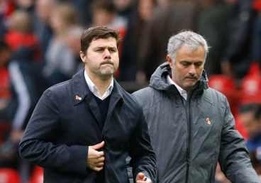Pochettino-and-Mourinho-walk-the-touchline-at-Old-Trafford